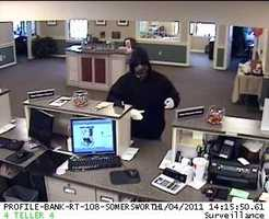"Somersworth Bank Robbery ((Press Release)) Somersworth police are investigating a robbery that took place on November 4th at 2:30 P.M. at the Profile Bank at 154 Route 108. A 911 call was made from The Profile Bank in Somersworth at 1430 hours. The caller indicated a man, armed with a knife, had robbed the bank. Somersworth Police units responded to the scene. It was learned that the suspect entered the bank, displayed a knife, and demanded money. He then fled the bank with a quantity of cash to an awaiting vehicle. The suspect proceeded to drive southbound on Route 108 towards Dover. An active investigation is on going. This investigation involves the New Hampshire State Police, The FBI, and The Somersworth Detective Division. The Dover Police provided assistance (Mobile Crime Van) and manpower to aid in processing the crime scene.Suspect description: Male 25 to 30 years of age6'0 to 6'3"" tallWearing Baggie JeansDark Blue Hooded SweatshirtTan work boots.Sunglasses Wearing a camouflaged Bandana, covering the lower portion of his face, below the sunglasses line. Also wearing White gloves.Vehicle: Small compact car, grey or silver with a rear trunk spoiler.The license plate was white with black letter.Anyone with information is asked to call the Somersworth Police Department 692-3131 or The Crime Line at 692-9111"