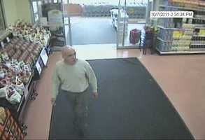 "Keene Energy Drink Theft ((Press Release)) On Oct. 7, 17, 21 and 22, 2011 the man pictured walked out of Keene area supermarkets with shopping carts full of energy drinks. Price Chopper, Shaw's, and Hannaford's report that he is taking Red Bull and Monster drinks along with other grocery items. The man is described as a white male in his 40's, bald, 5'6"" and 140 lbs. In one incident he is seen leaving in a white Jeep Cherokee with a MA registration. In another incident he is seen leaving in a small silver car with a second male who helped him load the car with the drinks. In a third incident, when he leaves the store, employees notice him making hand  signals to someone and an older model Cutlass, (either white or silver), is seen following him. On 10/23/11 KPD received a report of a stolen vehicle from Jake's Five Star. After reviewing video the officer realized that the subject who drives away in the car may be this same man. He was seen wearing a red ski hat, a red jacket and blue jeans. The vehicle  stolen is a green 2005 Dodge Magnum, NH 2446573. If you are able to identify this man, please contact Keene Police Officer Steve LaMears at (603) 357-9813 or the  Detective Bureau at (603) 357-9820."