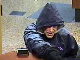 "Manchester Bank Robbery ((Press Release)) At approximately 9:00 AM on Friday, October 14, 2011, the Bank of America located at 1155 Elm St was robbed by a subject who appeared to be armed.  The suspect entered the bank with his right hand covered by some sort of black hat or glove.  He pointed this hand at the teller in a threatening manner and demanded money.  He was given an undisclosed amount of cash and promptly left the bank.  He was last seen heading towards the parking garage attached to 1155 Elm St. The suspect is described as a white male, 40-50 years of age, approximately 5'9"" tall and 180 pounds with a light, scruffy beard.  He was last seen wearing a blue hooded jacket, grey sweatpants with a strip on the outside of each leg and sneakers Anyone with information about this incident is encouraged to contact the Manchester Police Department at 66808711.  Anonymous tips for cash rewards can be made through Manchester Crimeline at 624-4040 or on line at manchestercrimeline.org."