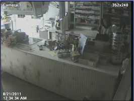 "Weare Burglary ((Press Release)) The Weare Police Department is investigating a burglary which occured on August 21, 2011 at approximately 12:30 a.m at Colburn's Country Store on Concord Stage Road. There are two suspects seen on surveillance video. You will see one of these people inside of the establishment. The other individual remains outside and peers in the window (point of entry). We believe the person inside of the store may be a female with a thin build and approximately 5' to 5' 2"" tall. A red vehicle may be involved. Anyone with information is asked to call Weare Police at 603-529-7755"
