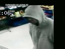 "Keene Robbery ((Press Release)) On 26 September 2011 at approximately 2040 hours, Keene Police Officers responded to a report of a robbery at the K&S Market on North Street in Keene.  Initial reports indicated that a white male had entered the market, and walked up to the on-duty clerk and demanded cash.  The clerk turned over an undisclosed amount of money.No weapons were shown nor was anyone injured during this incident.  The suspect's description is as follows:White male, Early 30's in age, Scruffy facial hair, Dark colored hair, Brown eyes, ""Pitted face""…like acne scars, Heavy set, approximately 5'09'' tall,Wearing a Gray hooded sweatshirt with crest logo on left side. Gray sweatpantsDark colored (possibly black) t-shirt seen underneath the gray sweatshirt. Sneakers appear to be basketball sneakers, dark colored along sides (from heel to toe) with a white stripe up the laces. The following photographs have been provided from the K&S Market surveillance system.  The Keene Police Department is requesting the assistance from the public in identifying the suspect involved in this robbery."
