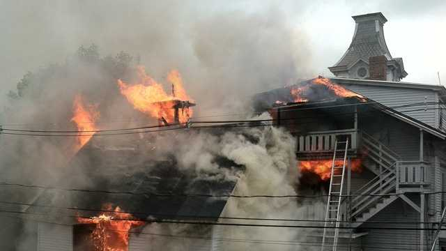 Firefighters responded to a three-alarm fire in Manchester on Monday.