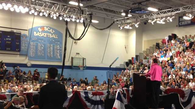 Shaheen speaks to the crowd at Oyster River High School.