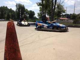 Erin and Sean race go-karts.