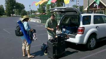 The Chronicle crew unloads tripods, cables, and cameras upon arrival.