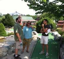 Sean and the crew check a possible shooting location for adequate lighting.