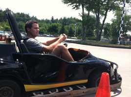 Sean McDonald sits behind the wheel of a go-kart.