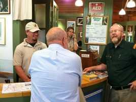 Fritz talks to the staff.