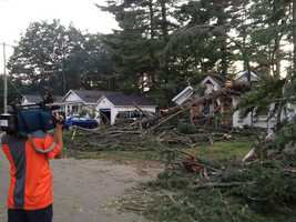 8:39 pm: Jean Mackin and her photographer shoot storm damage in Tilton.