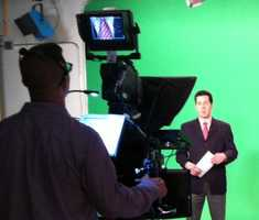 11:01 pm: Adam Sexton gets in position in front of the green screen for the 11 p.m. news.