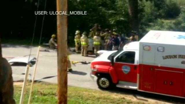 A fiery crash in Loudon trapped the driver, and had an off duty firefighter running to the rescue.