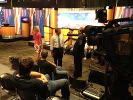 Some WMUR crew members do a run-through in the debate hall.