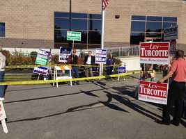 Supporters line up outside a polling location in Barrington.