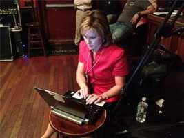 Working at Jackie Cilley's watch party. Heather watches results as they come in.