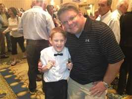 """From News 9's Jean Mackin: """"One of my favorite people in the world preparing to sing 'God Bless America' at Lamontagne headquarters. Eleven-year-old Christopher Duffley from Manchester is blind, autistic and inspiring. He's pictured here with his friend."""""""