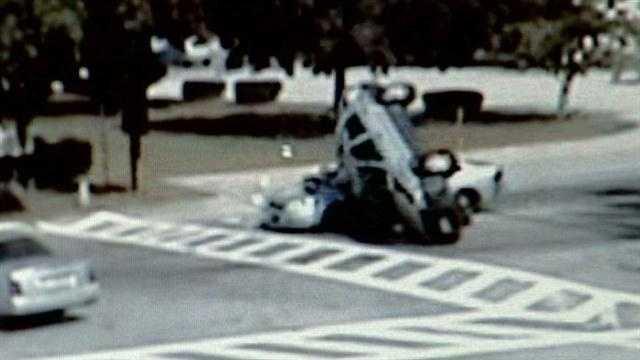 SUV rolls onto police cruiser
