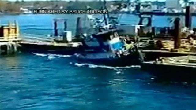 A tugboat sinks in Portsmouth.