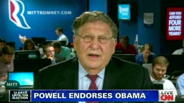 A top adviser to Mitt Romney is backing away from his suggestion that fellow Republican Colin Powell endorsed Barack Obama because both men are black.