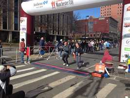 Runners cross the finish line for the 2012 Manchester Marathon.