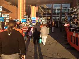 Supporters for both parties line up outside a polling location in Exeter.