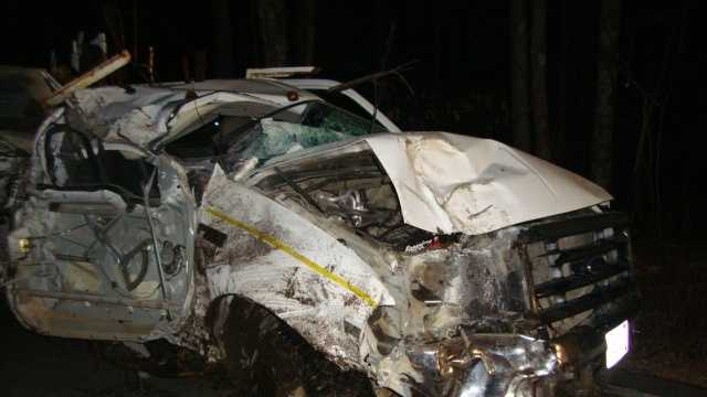 The 1999 Ford suffers substantial damage after striking several trees