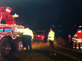 Emergency crews pulled a man out from frigid waters Thursday night after his car crashed into Round Pond.
