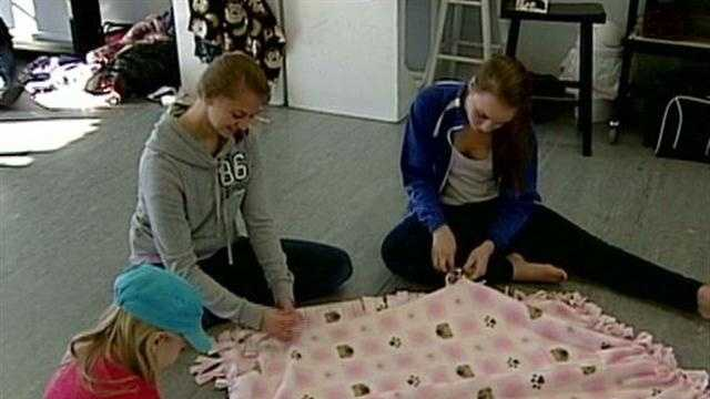 Local students create blankets for Sandy victims