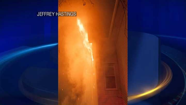 Flames burn out the window of an apartment on Manchester's Valley Street