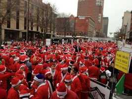 RACE OF THE YEAR: The Santa Claus Shuffle on Dec. 1. What an amazing sight, a long red line of 2.500 runners in Santa Claus suits as far as you could see down Elm street. Add to that the incredible timing of snow flurries (we did not see many of them in December, but they arrived for this race), and excellent red race shirts, and we have a winner! Read Jamie's full blog.