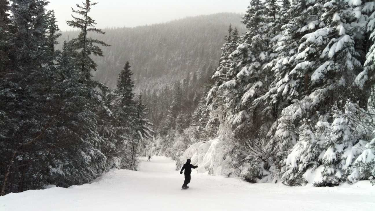 A snowboarder selects No-Grit on Waterville Valley, Sunday, after about eight inches of snow fell the day before.