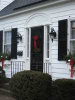 Add storm doors that help keep cold air out and are compatible with the home's architecture.