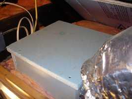 Build rigid foam boxes around bathroom ventilation fans in the attic, then insulate around the box.