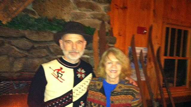 Wayne and Sally Patenaude, founders and owners of Pat's Peak ski area in Henniker, pose at a fireplace at the ski area Sunday night during a 50th Anniversary party for friends, family and close business associates.