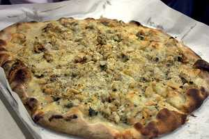 """Ray says he also puts meat on his pizza, but to switch it up, he likes white clams. """"Pepe's Pizza in New Haven, Conn., makes a white clam pizza that is close to heaven."""""""
