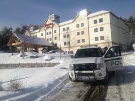 An arrest has been made in the stabbing death of a woman at a Littleton hotel Monday night.
