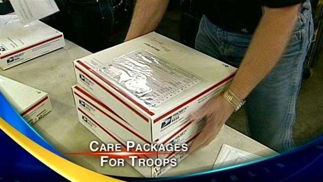 New Hampshire Gov. Maggie Hassan and other volunteers package American staples like beef jerky, gum, ramen noodles and candy for American troops serving in Afghanistan.