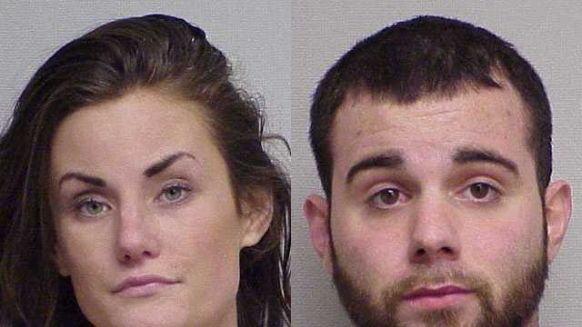 Portsmouth police say they have arrested two people in connection with a robbery at a grocery store.