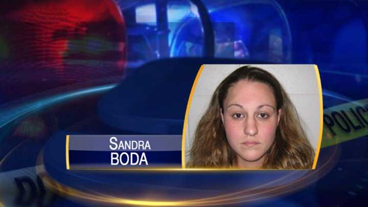 Woman accused of theft by deception