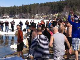 Dozens of people, including police officers, the state attorney general, and WMUR's Adam Sexton all braved the icy water.