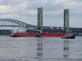 A large ship broke free from the state pier and floated up the Piscataqua River, colliding with the Sarah Long Bridge on Monday.
