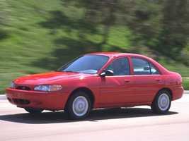 """""""My first car was a 1998 Ford Escort sedan in bright red. Yuck!"""" said Melinda."""