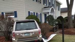 img-Collision sends car into building