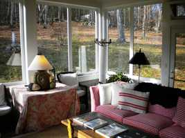 It also features a glassed-enclosed four season porch designed to enjoy the wooded setting and the natural surroundings throughout the year.