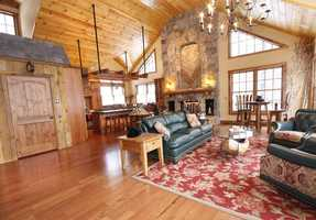 A sitting room on the second level and family room on the lower level offer a wide variety of entertainment.