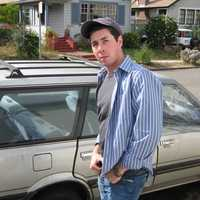 "Adam's first car was a 1987 Subaru GL Wagon. ""I once drove it from Des Moines to Utah in one day,"" said Adam."