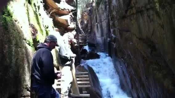 About 500 feet of boardwalk inside the Flume Gorge was returned to its summer spot along the granite walls on Tuesday.