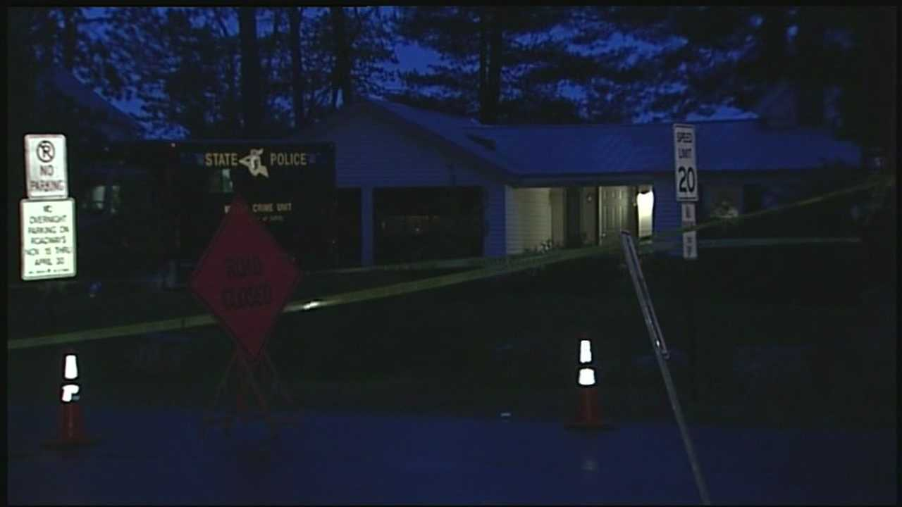 Police investigate a double murder in Belmont