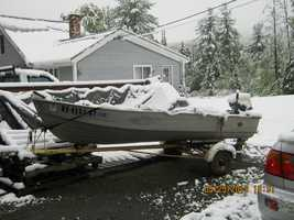 This boat in Littleton may be ready for some spring fishing, but the weather is not.