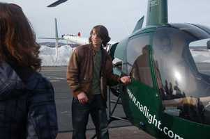 Jake shows his friends the copter