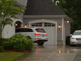 An Audi Q7 is seen driving up to and parking inside the garage of Aaron Hernandez's home.